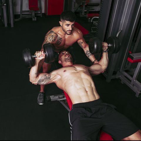 Muscular men training in gym