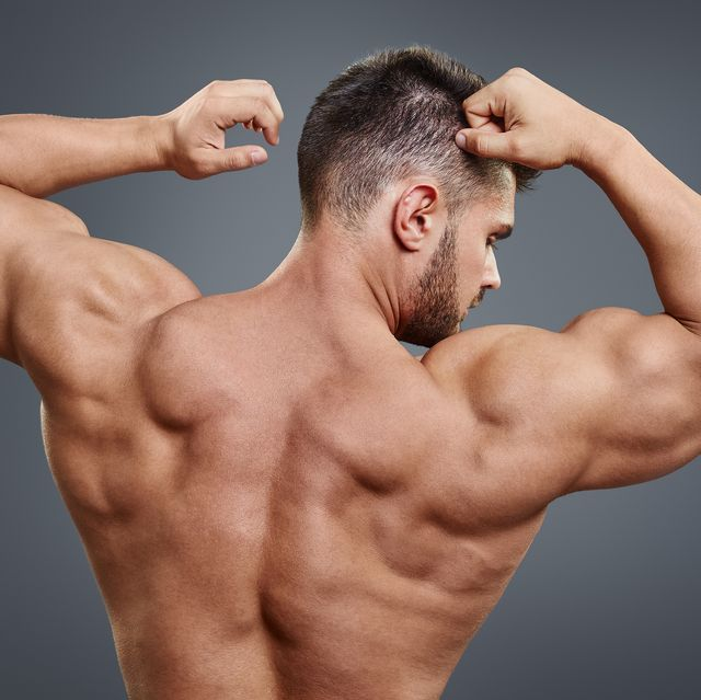 strong athletic man back on grey background