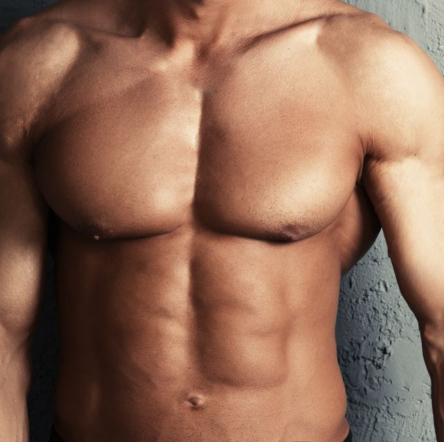 Muscular torso of bodybuilder