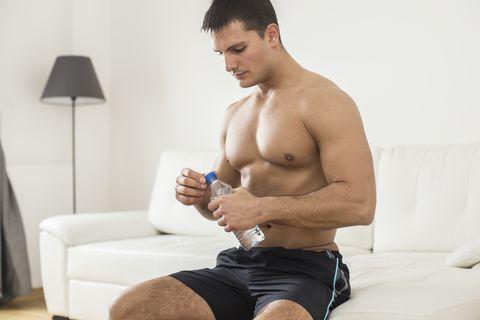 Muscular young man relaxing