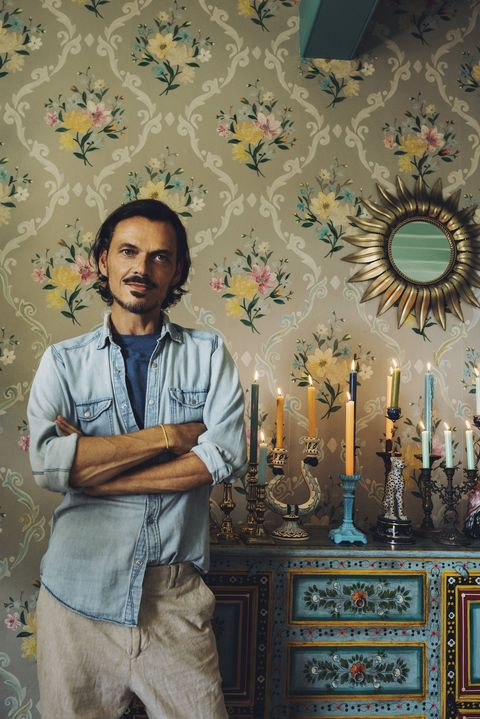matthew williamson with his candlestick collection