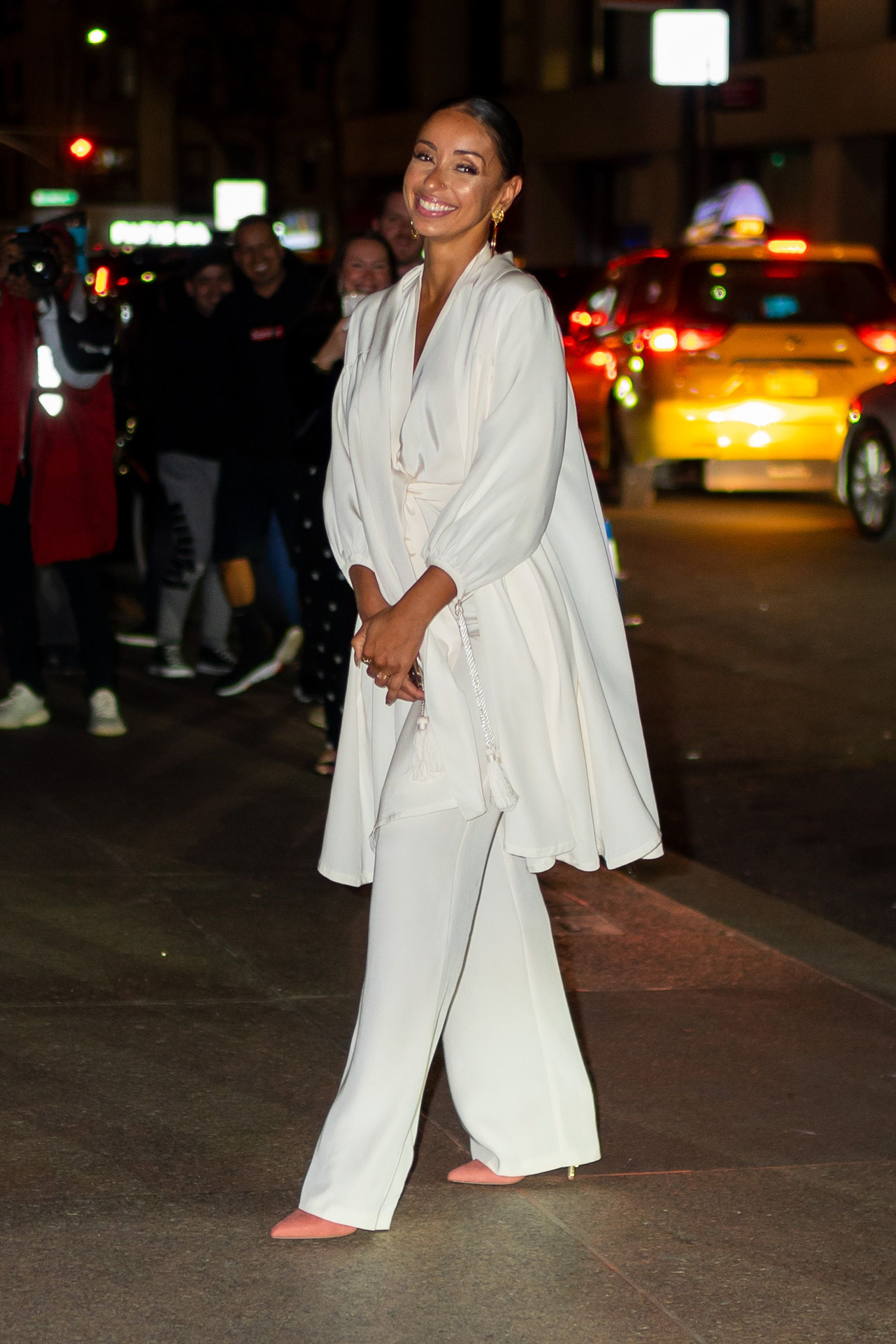 The singer-songwriter wore a cream ensemble with coral pumps.