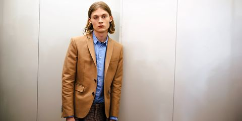 Clothing, Outerwear, Blazer, Suit, Jacket, Fashion, Yellow, Standing, Overcoat, Human,