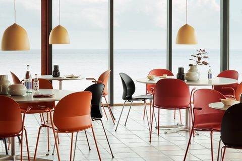 Furniture, Room, Table, Dining room, Chair, Interior design, Orange, Restaurant, Kitchen & dining room table, Material property,