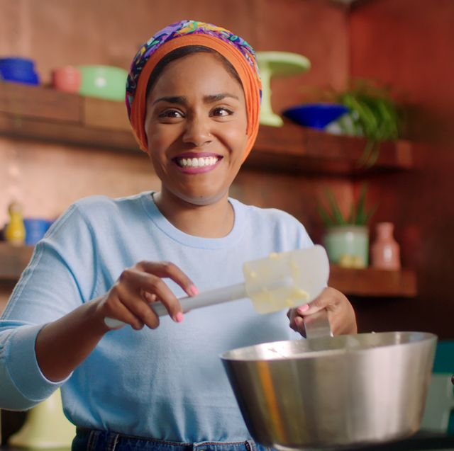 "nadiya hussain in episode 1 ""indulgent desserts"" of nadiya bakes season 1 c courtesy of netflix © 2021"