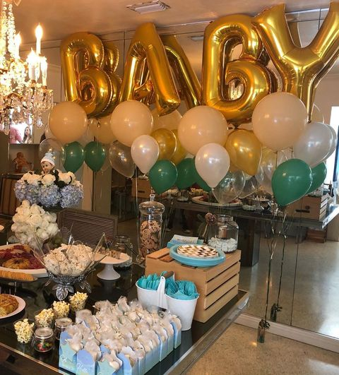 Balloon, Party supply, Turquoise, Interior design, Architecture, Table, Party, Toy, Ceiling, Tableware,