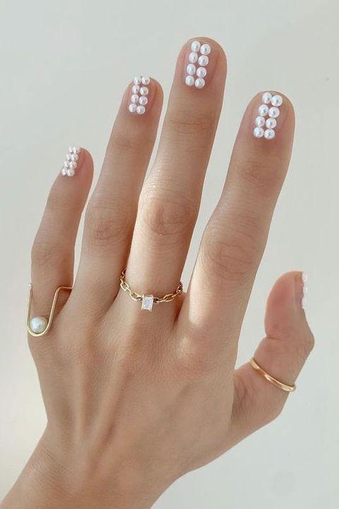 Nail, Finger, Hand, Manicure, Nail care, Skin, Nail polish, Cosmetics, Material property, Flesh,