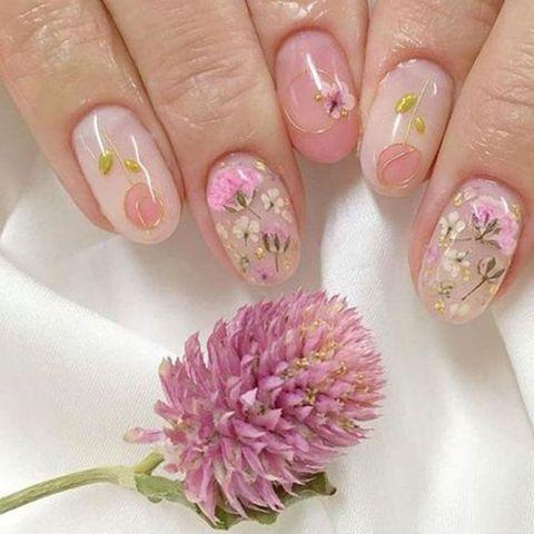 Nail, Manicure, Nail polish, Nail care, Pink, Finger, Cosmetics, Hand, Material property, Plant,