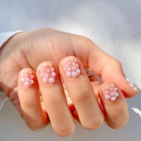 Nail, Nail polish, Nail care, Finger, Manicure, Cosmetics, Skin, Orange, Peach, Hand,