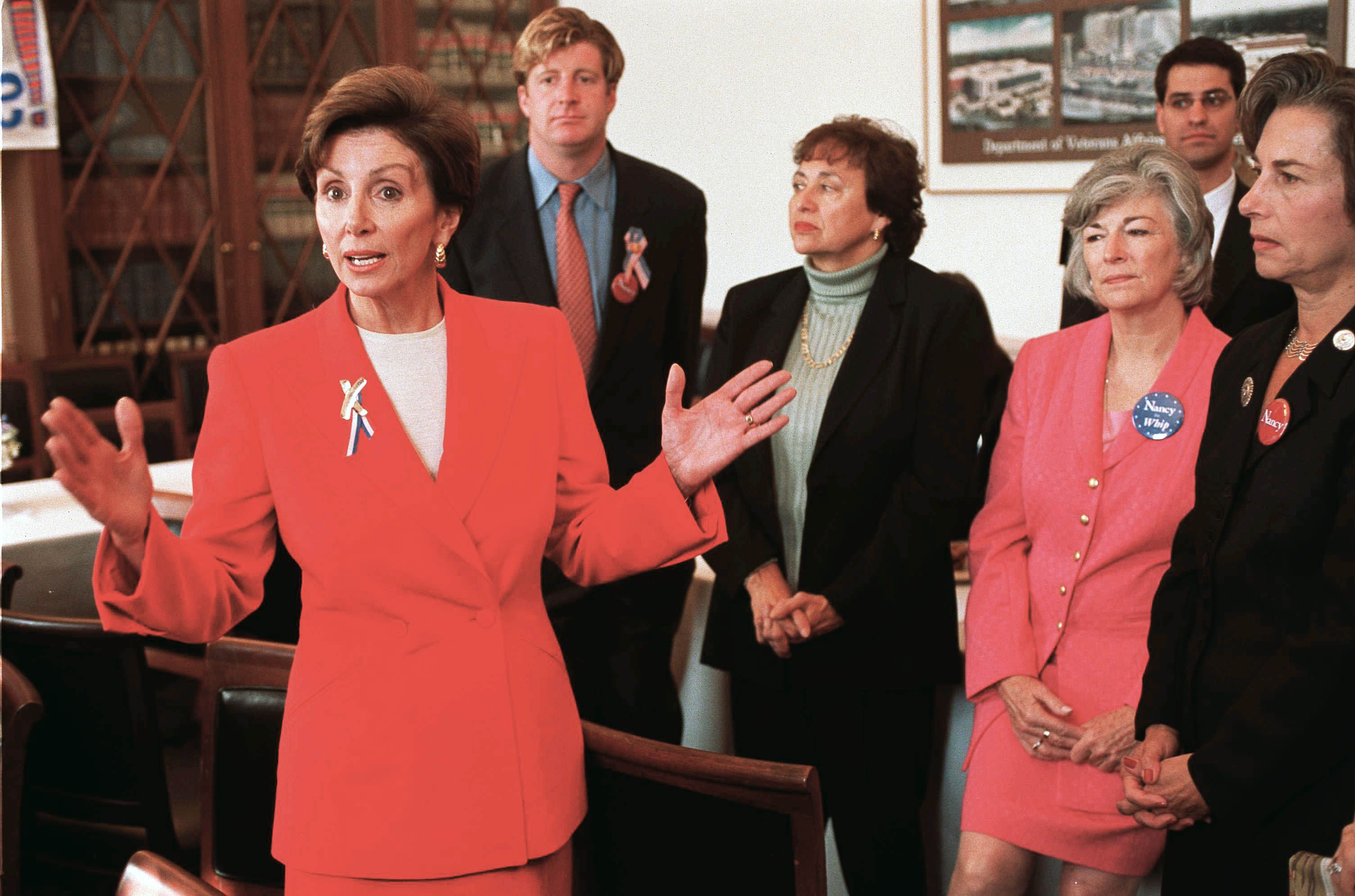 Pelosi speaking to reporters after being elected as the House Minority Whip.