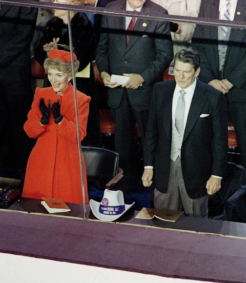 president ronald reagan and first lady nancy reagan stand on the reviewing platform as the inaugural parade passes by on washington, dc's pennsylvania avenue, jan 20, 1981 also visible in a white cowboy hat president reagan was presented with ap photo