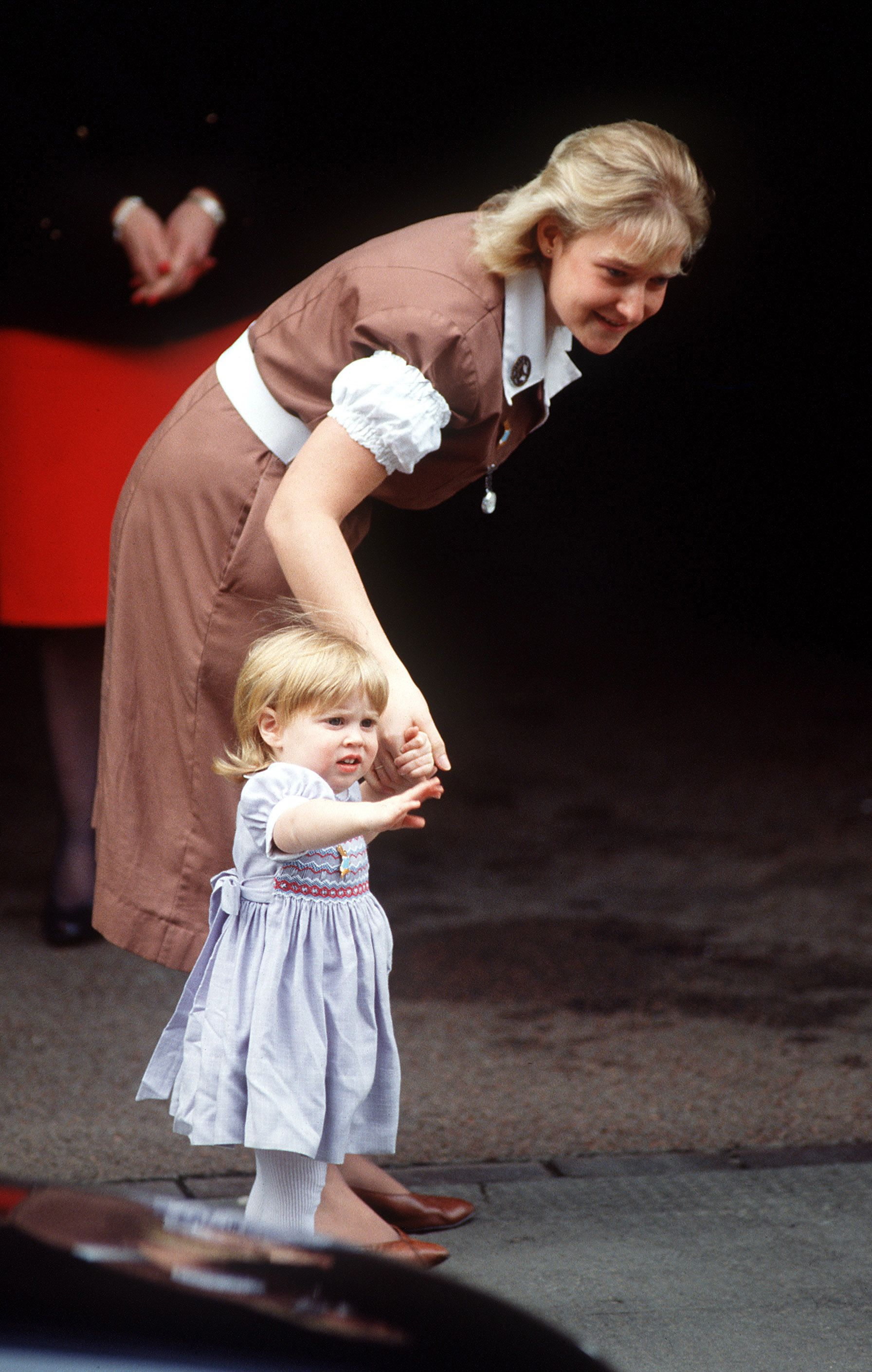 Princess Beatrice with her nanny Alison Wardley on their way to the hospital to visit her new baby sister, Eugenie.