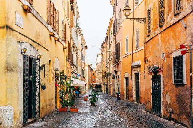 narrow cobbled street in trastevere neighborhood, rome, italy