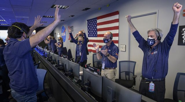 members of nasa's perseverance rover team react in mission control after receiving confirmation the spacecraft successfully touched down on mars, thursday, feb 18, 2021, at nasa's jet propulsion laboratory in pasadena, california a key objective for perseverance's mission on mars is astrobiology, including the search for signs of ancient microbial life the rover will characterize the planet's geology and past climate, pave the way for human exploration of the red planet, and be the first mission to collect and cache martian rock and regolith photo credit nasabill ingalls