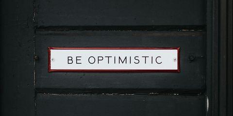 Optimism sign on door