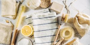 Natural cleaning products lemon and baking soda with bamboo dish brushs. Eco friendly. Zero waste concept. Plastic free.