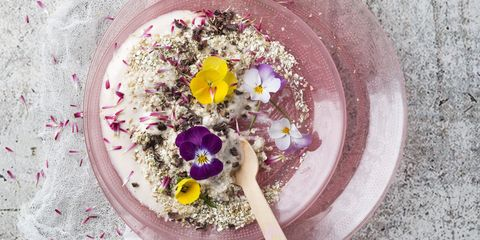 Natural yoghurt with buckwheat grits, edible flowers and cacao nibs