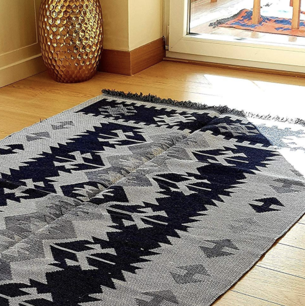 navy and gray aztec rug with fringe ends