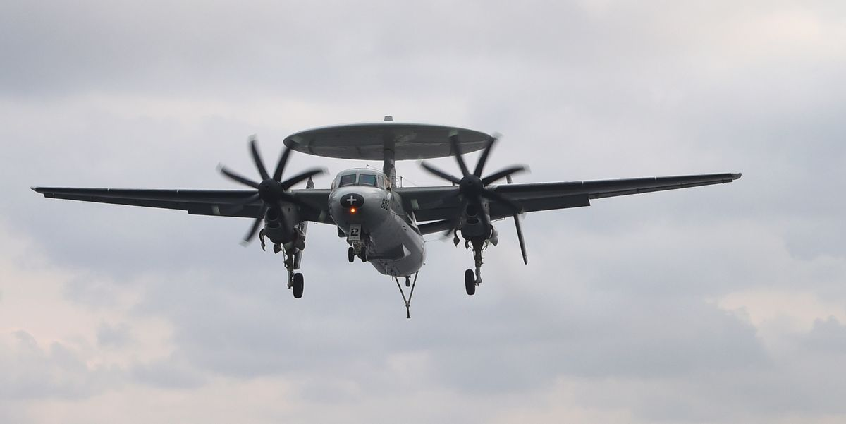 navy crew members look at an e 2c hawkeye as it lands on news photo 1598985799 jpg?crop=0 699xw:0 520xh;0 00801xw,0 0618xh&resize=1200:*.