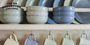Crockery shelves with blue and green plates and cups