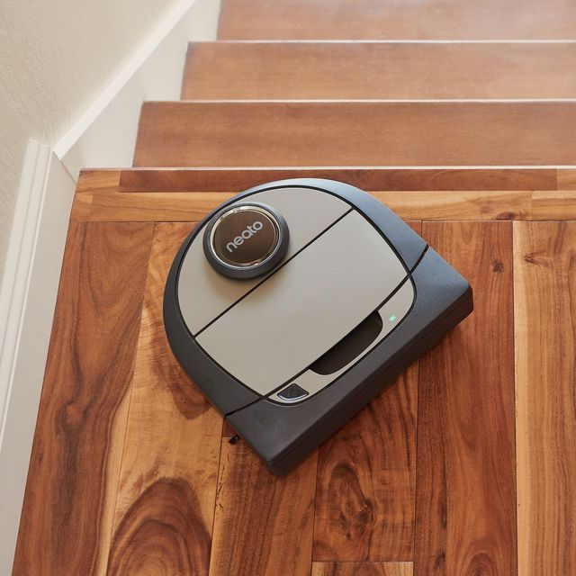 neato robot vacuum on top of stairs