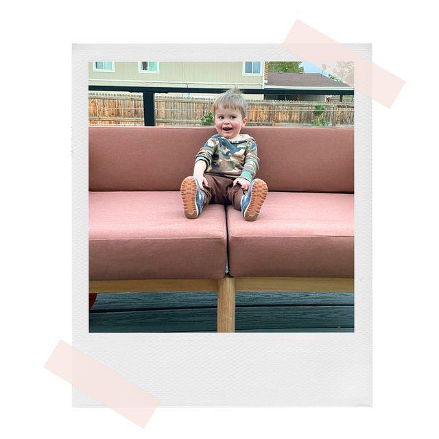 toddler sitting on neighbor outdoor sofa