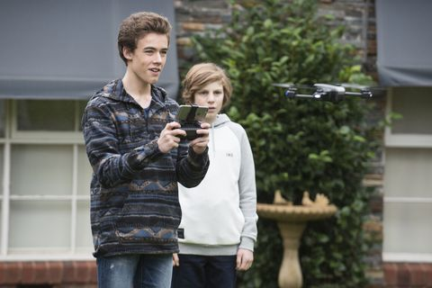 louis curtain and emmett donaldson play with hendrix greyson's drone in neighbours