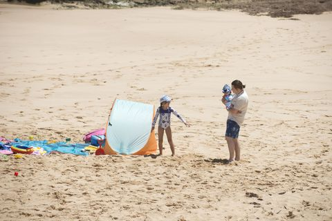 Callum Rebecchi with Nell and Hugo at the beach in Neighbours