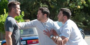 Mark Brennan clashes with Finn Kelly and Shaun Watkins in Neighbours