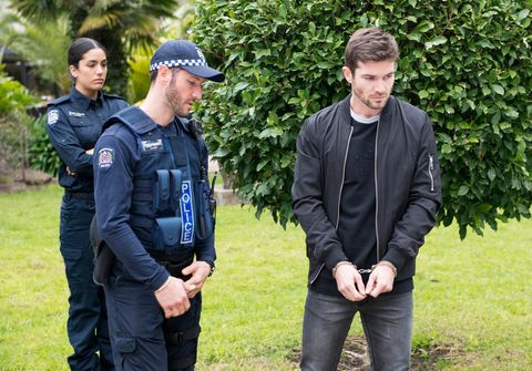 ned willis is arrested as yashvi rebecchi watches on in neighbours