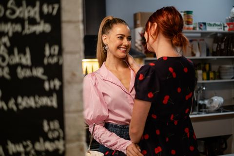 chloe brennan and nicolette stone are interrupted as they share a moment in neighbours