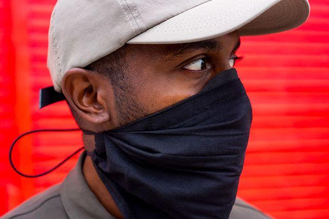 a man wearing a bandana style face mask
