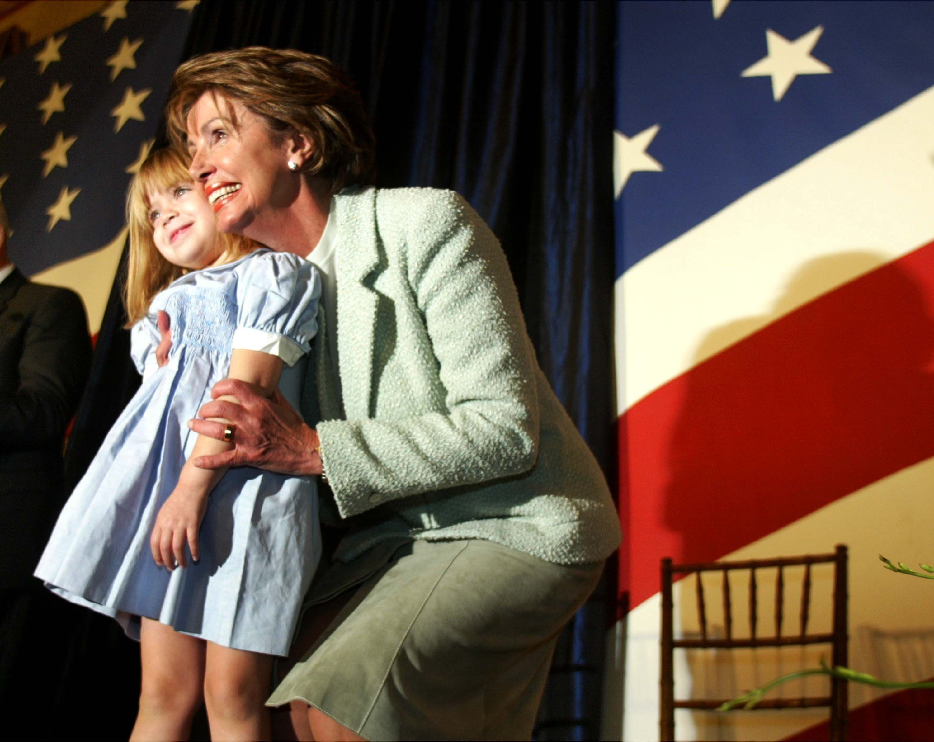 Pelosi hugs her granddaughter at the swearing in ceremony.