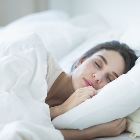 USA, New Jersey, Jersey City, Woman sleeping in bed