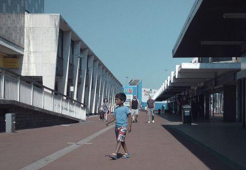 Architecture, Snapshot, Town, Sky, Urban area, Walkway, Footwear, Road, Infrastructure, Tree,