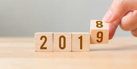 New year 2018 change to 2019 concept. Hand flip over wood cube block