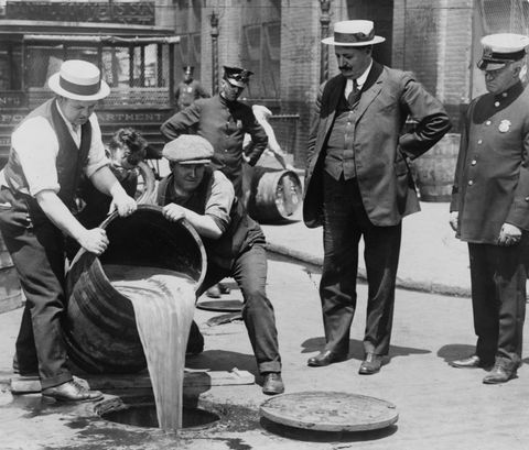 vintage photos   pouring out illegal alcohol into a sewer