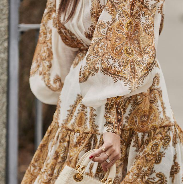 Clothing, Fashion, Dress, Yellow, Beige, Fashion design, Outerwear, Tradition, Wedding dress, Peach,