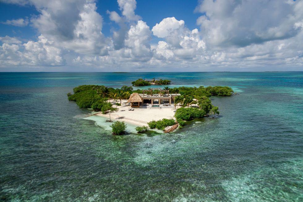 Dit privé eiland voor de kust van Belize is alles waar je ooit van gedroomd hebt