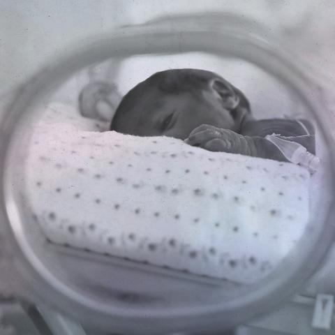 a newborn baby in the nicu