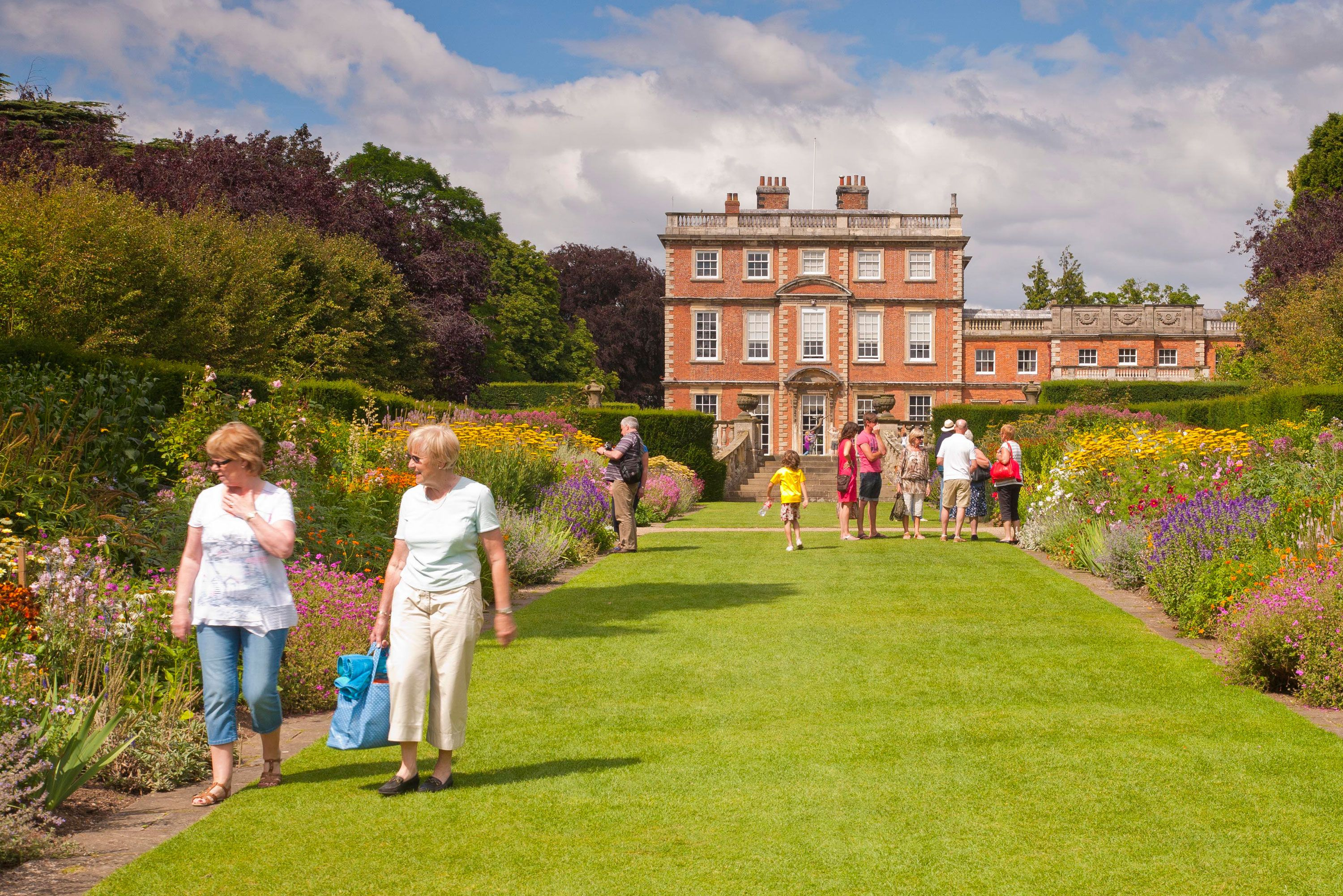 The long walk up to Newby Hall, showing visitors admiring the flowerbeds.