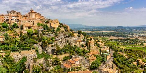 Landmark, Town, Mountain village, Human settlement, Natural landscape, Village, Tourism, Sky, City, Building,