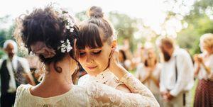 Newlywed lesbian couple dancing
