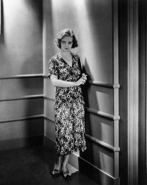 Actress Bette Davis Posing in Patterned Dress in Bad Sister