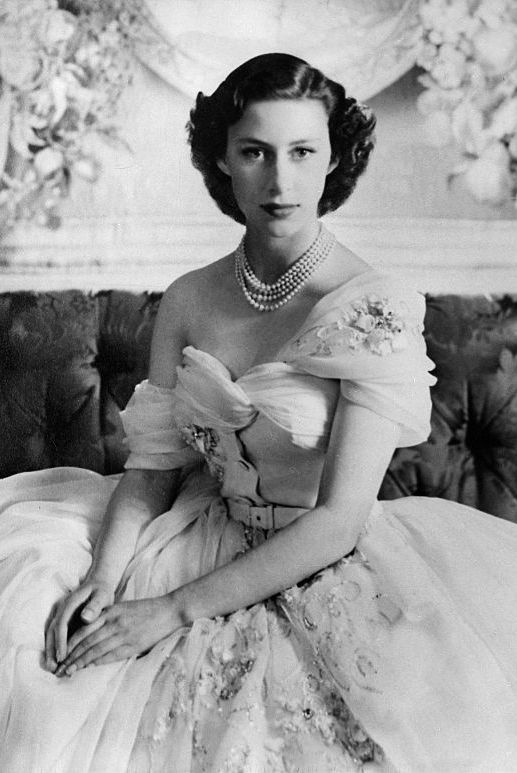 In 1951, Margaret posed for a birthday portrait taken by Cecil Beaton in a one-shouldered cream gown with gold embellishment by Christian Dior.