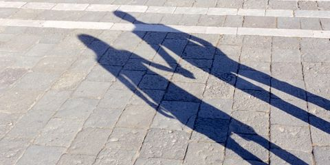this writing exercise can strengthen a marriage; shadow of couple holding hand