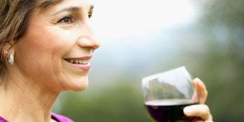Smile, Mouth, Glass, Eye, Drink, Stemware, Wine glass, Eyebrow, Alcohol, Alcoholic beverage,