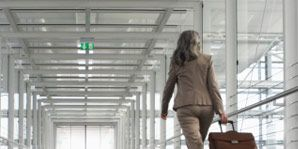 germy airports-woman with suitcase
