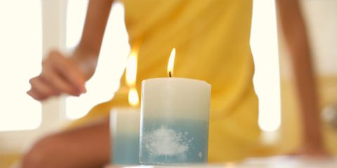Essential oils can benefit the heart; woman with scented candles
