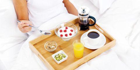 the ideal breakfast plan; woman eating breakfast